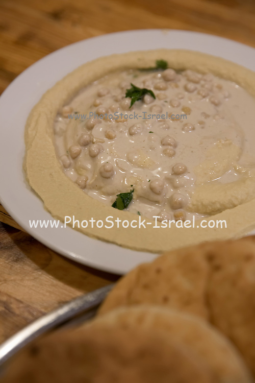 A serving of Humus, tahini, Olive oil and Parsley a Middle eastern paste made from chickpeas