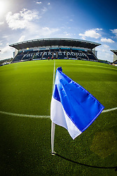 The flag on the half-way line at Falkirk Stadium, with the new pitch, for the Scottish Championship game v Hamilton. The woven GreenFields MX synthetic turf and the surface has been specifically designed for football with 50mm tufts compared with the longer 65mm which has been used for mixed football and rugby uses.  It is fully FFA two star compliant and conforms to rules laid out by the SPL and SFL.<br /> ©Michael Schofield.