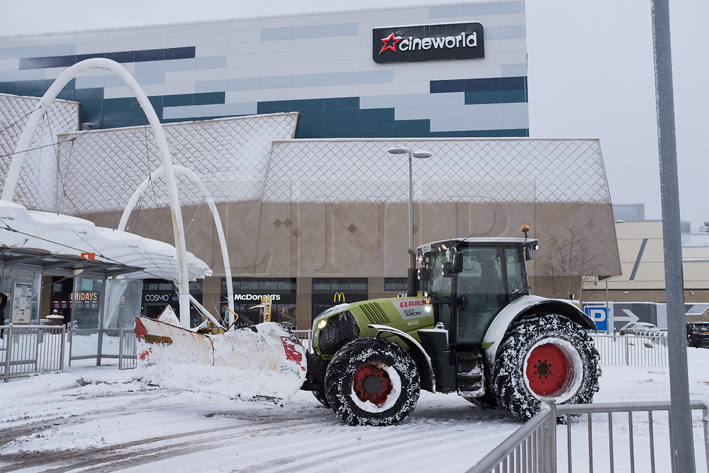 """© Licensed to London News Pictures. 28/02/2018. <br /> <br /> A plower clears the road at the Silverburn Centre, Glasgow, Scotland as the city hit with snow storm """"Beast from the East"""" on 28th February 2018.<br /> <br /> Photo credit should read Max Bryan/LNP"""