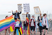 Religious protesters alongside LGBTQ community during the annual Brighton Pride parade on the 3rd August 2019 in Brighton in the United Kingdom.