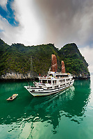 Aclass Cruises Stellar in Halong Bay, North Vietnam. The bay features 3,000  limestone and dolomite karsts and islets in various shapes and sizes sprinkled over 1,500 square kilometers. It offers a wonderland of karst topography. It is a UNESCO World Heritage Site.