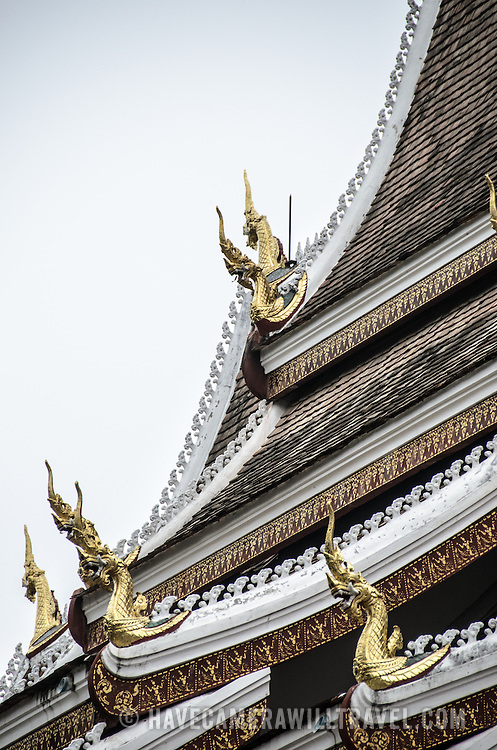 Ornamental gold-leaf chofahs adorn the roof of a wat (Buddhist temple) in Luang Prabang, Laos. The hornlike architectural ornaments represent Garuda, a mythical creature that is half man and half bird that carried the Hindu god Vishnu.