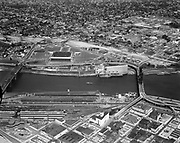 Y-620608A-01.  aerial of Coliseum area, Willamette river, looking east. June 8, 1962