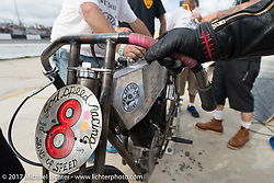 Freddie Bollwage with his crew as they work on his 1921 Harley-Davidson J in between heats at Billy Lane's Sons of Speed vintage motorcycle racing during Biketoberfest. Daytona Beach, FL, USA. Saturday October 21, 2017. Photography ©2017 Michael Lichter.