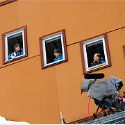 Judges in the scoring building wait for action to resume at the Ski Jumping competition during the 2010 Winter Olympics at Whistler Olympic Park. (Nikon D3 with 400 2.8)