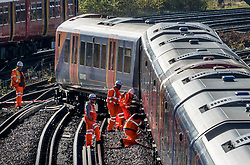 © Licensed to London News Pictures. 06/11/2017. London, UK.  Rail workers inspect a derailed train outside Wimbledon Station. The commuter train heading into central London suffered a low speed derailment as it left Wimbledon. It is being reported that one passenger suffered minor injuries and 300 were evacuated. Photo credit: Peter Macdiarmid/LNP