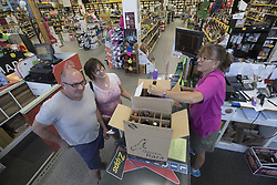 July 2, 2017 - Minneapolis, MN - Minnesota, USA - Jennifer Schoenzeit at right ,co-owner of Zipps Liquors with her brother Andy Schoenzeit checked out two case of wine for customers Thomas Johnson and, Lea Johnson Minnesota July 2, 2017 in Minneapolis, MN.  Her father Mickey started the family Liquor business in 1961.]   JERRY HOLT • jerry.holt@startribune.com (Credit Image: © Jerry Holt/Minneapolis Star Tribune via ZUMA Wire)