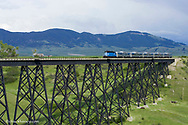 Charlie Russell Chew Choo Choo Train crosses Large trestle near Lewsiton Montana