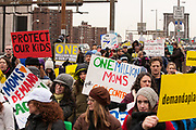 A mass of marchers bearing signs at the Manhattan end of the Brooklyn Bridge.