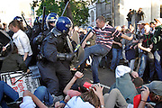 London, England, 15/09/2004..An estimated 20,000 hunt supporters demonstrate in Parliament Square as a new bill to ban hunting with dogs is passed. Some demonstrators fought with riot police, and five hunt supporters managed to get onto the House of Commons floor during the debate..Police charge demonstrators sitting in the street outside Parliament.