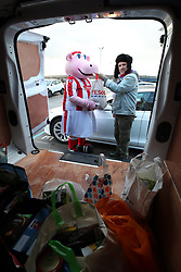 Steven Powell donates to the food bank appeal outside the Bet365 Stadium ahead of the Sky Bet Championship match between Stoke City' and Ipswich Town