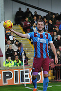Scott Wiseman of Scunthorpe United holds the ball out towards Barnsley fans  during the Sky Bet League 1 match between Scunthorpe United and Barnsley at Glanford Park, Scunthorpe, England on 31 October 2015. Photo by Ian Lyall.