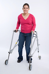 Young woman with Cerebral Palsy using a walking frame, ,