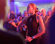 Garden City, New York, U.S. November 14, 2019. Freeport High School Select Chorale members perform – with Director MONIQUE RETZLAFF facing the singers – during the 17th Annual Cradle of Aviation Museum Air and Space Gala. The event helped support the development of new activities and educational programs, and honor the innovations of leaders in aviation, technical achievement, and leadership.