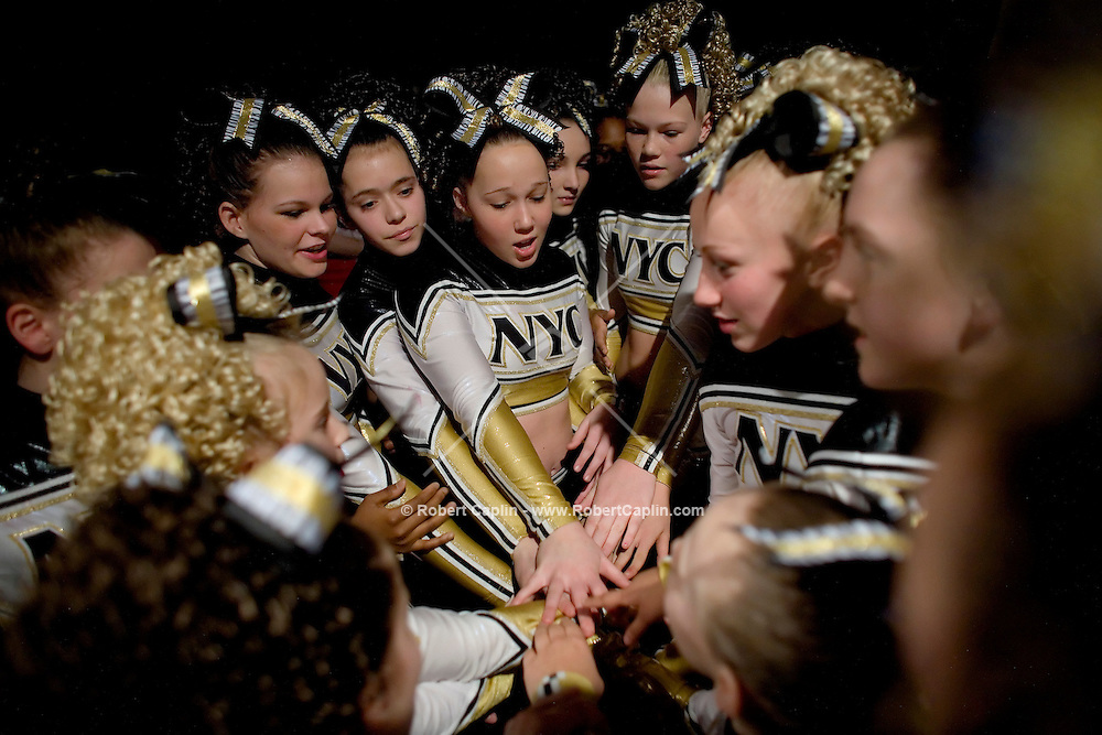 The NY Cheer Jr. Gold gives a cheer before going on stage to  compete in the NCA/NDA U.S. Championship held at the Hammerstein Ballroom Sat. March 10, 2007. Rising popularity in the sport of cheerleading has brought a significant increase in cheerleading related accidents and injuries.