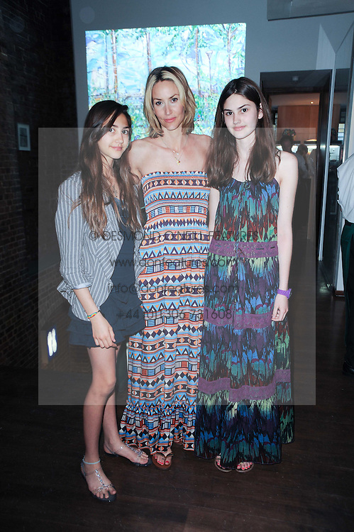 Centre LISA BUTCHER and her daughters Left to right, AMBER DONOSO and OLIVIA DONOSO at a private view of Sacha Jafri's paintings entitled 'London to India' held in aid of The Elephant Family charity at 23 Macklin Street, Covent Garden, London on 3rd June 2010.