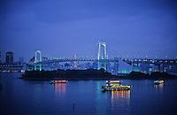 Rainbow Bridge. Evening in Odaiba. Odaiba is an artificial Island in the Tokyo Bay area, linked by Rainbow Bridge.