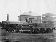 London & South Western Railway (LSWR) Locomotive No 148, 'Colne' with its tender.  This 2-4-0 steam locomotive was built as the Somerset & Dorset Railway No 12 by G England & Co in London in 1863 and sold to LSWR in 1877. Photograph.