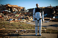 A Star Wars movie character mannequin stands outside a tornado destroyed house in Oklahoma City, Oklahoma May 22, 2013.  The owner of the house collected movie memorabilia. Rescue workers with sniffer dogs picked through the ruins on Wednesday to ensure no survivors remained buried after a deadly tornado left thousands homeless and trying to salvage what was left of their belongings.  REUTERS/Rick Wilking (UNITED STATES)