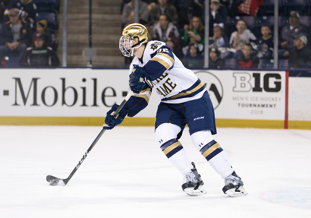 March 10, 2018:  Notre Dame defenseman Andrew Peeke (22) skates with the puck during NCAA Hockey game action between the Notre Dame Fighting Irish and the Penn State Nittany Lions at Compton Family Ice Arena in South Bend, Indiana.  Notre Dame defeated Penn State 3-2.  John Mersits/CSM