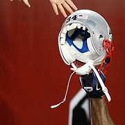 New England fans touch a players helmet as he leaves the field after winning an NFL football game against the Tampa Bay Buccaneers at Raymond James Stadium on Thursday, August 18, 2011 in Tampa, Florida.   (Photo/Alex Menendez)