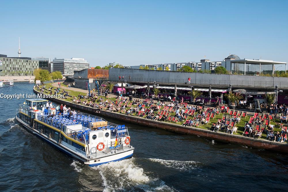 Busy riverside bar beside Spree Rive run Berlin Germany