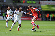 Southampton's Adam Lallana (r) breaks past Swansea's Dwight Tiendalli.Barclays Premier league match, Swansea city v Southampton at the Liberty stadium in Swansea, South Wales on Saturday 3rd May 2014.<br /> pic by Andrew Orchard, Andrew Orchard sports photography.