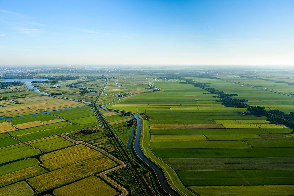 Nederland, Noord-Holland, Gemeente Purmerend, 13-06-2017;  polder Wijdewormer, droogmakerij uit de 17e eeuw. Spoorweg Purmerend-Zaandam ter hoogte van Purmerland.<br /> Wijdewormer polder, reclaimed land dating from the 17th century.<br /> luchtfoto (toeslag op standard tarieven);<br /> aerial photo (additional fee required);<br /> copyright foto/photo Siebe Swart