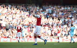 Arsenal's Per Mertesacker applauds the fans during the Premier League match at the Emirates Stadium, London.