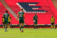 Notts County striker Kyle Wootton (14) carries the ball back to the centre circle during the Vanarama National League Promotion Final match between Harrogate Town and Notts County at Wembley Stadium, London, England on 2 August 2020.