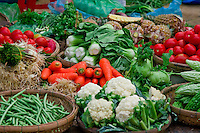 Garden fresh vegetables for sale at a local street market in Hoi An.