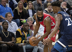 April 23, 2018 - Minneapolis, MN, USA - The Rockets' James Harden (13) is defended by the Timberwolves' Jimmy Butler (23) in the third quarter in Game 4 of their series Monday, April 23, 2018 at the Target Center in Minneapolis, Minn. The Rockets won, (Credit Image: © Carlos Gonzalez/TNS via ZUMA Wire)