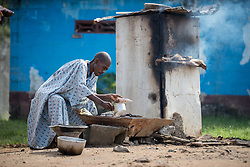 2 November 2019, Ganta, Liberia: A male patient at the Ganta United Methodist Hospital prepares a meal. The hospital provides kitchen facilities for patients who wish to cook for themselves during their stay. Located in Nimba county, the Ganta United Methodist Hospital serves tens of thousands of patients each year. It is a founding member of the Christian Health Association of Liberia.