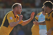 Lee Minshull of Newport (l) celebrates scoring his side's equalising goal with Danny Crow. Skybet football league two match, Newport county v Exeter city at Rodney Parade in Newport, South Wales on Sunday 16th March 2014.<br /> pic by Mark Hawkins, Andrew Orchard sports photography.