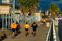 U.S. Navy personnel from the nearby Naval Base Coronado running on Coronado Island (San Diego), California USA.