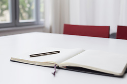 Notebook and pen on table, close up
