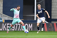 Swansea City Midfielder Matt Grimes(8) and Millwall midfield Billy Mitchell(24)  battles for possession during the EFL Sky Bet Championship match between Millwall and Swansea City at The Den, London, England on 10 April 2021.