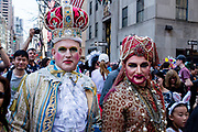 New York, NY - April 16, 2017. Two men in exotic bejeweled headpieces and costumes at New York's annual Easter Bonnet Parade and Festival on Fifth Avenue.