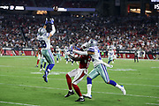 Arizona Cardinals rookie wide receiver Chad Williams (16) is tightly covered by Dallas Cowboys cornerback Orlando Scandrick (32) as Dallas Cowboys strong safety Jeff Heath (38) leaps and nearly intercepts a fourth quarter deep pass during the 2017 NFL week 3 regular season football game against the against the Dallas Cowboys, Monday, Sept. 25, 2017 in Glendale, Ariz. The Cowboys won the game 28-17. (©Paul Anthony Spinelli)