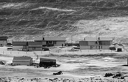 Heavy storm and surf at the coastline in Grimsey, north of Iceland.  The homes are vulnerable compared to mother nature - Stormur og öldur við ströndina  í Grímsey, hús og byggingar eru smáar í samanburði