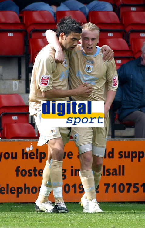 Photo: Dave Linney.<br />Walsall v Bristol City. Coca Cola League 1. 08/04/2006.<br />Bristol's Dave Cotterill(R) makes it 1-0.   Liam Fontaine congratulates the scorer.