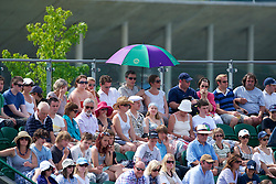 LONDON, ENGLAND - Wednesday, June 23, 2010: Fans shelter from the sun during the Gentlemen's Singles 2nd Round on day three of the Wimbledon Lawn Tennis Championships at the All England Lawn Tennis and Croquet Club. (Pic by David Rawcliffe/Propaganda)