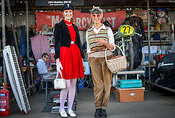 © Licensed to London News Pictures.09/09/2018. Goodwood. West Sussex, UK. <br /> The Goodwood motor circuit celebrates the 20th anniversary of the Revival.The Revival has become one of the biggest annual historic motorsport events in the world and the only one to be staged entirely in period dress. Each year over 150,000 people descend on this quiet corner of West Sussex to enjoy the three-day event.<br /> Pictured. Mum and daughter, Fran and Lisa Smith from Winchester. <br /> Photo credit: Ian Whittaker/LNP
