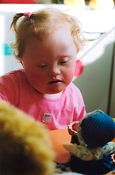 Toddler with Downs Syndrome in Mencap nursery Leeds UK