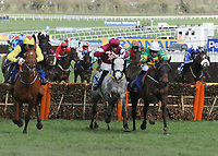 National Hunt Horse Racing - 2019 Cheltenham Festival - Thursday, Day Three (St Patrick's Day)<br /> <br /> Winner, Barry Geraghty on Sire Du Berlais (right) goes head to head with E Walsh on Tout Est Permis (centre) and Davy Russell on The Story teller after jumping the last fence in the 14.10 Pertemps Network Final Hanicap Hurdle race (Grade 3, Class 1), at Cheltenham Racecourse.<br /> <br /> COLORSPORT/ANDREW COWIE