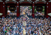 Participants representing 44 city districts carry palanquins into the courtyard of Sensoji Shrine. Sanja Matsur (Three Shrine Festival), is an annual Shinto festival held in Tokyo. The earliest form of the festivals dates back to the 7th century CE and is held in honor of Hinokuma Hamanari, Hinokuma Takenari and Hajino Nakatomo, the three men who established and founded Sensō-ji temple. Sanja Matsuri is held on the third weekend of every May at Asakusa Shrine. Its  parades revolve around three mikoshi (three portable shrines referenced in the festival's name), as well as traditional music and dancing.