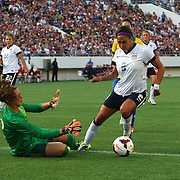 Brazil goalkeeper Luciana (12) makes a save against U.S. forward Sydney Leroux (2) during a women's soccer International friendly match between Brazil and the United States National Team, at the Florida Citrus Bowl  on Sunday, November 10, 2013 in Orlando, Florida. The U.S won the game by a score of 4-1.  (AP Photo/Alex Menendez)