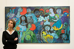 "© Licensed to London News Pictures. 29/03/2019. LONDON, UK. A staff member stands next to ""Esperando da Paz"", by Malangatana Ngwenya (Est. GBP 8,000-12,000). Preview of Sotheby's upcoming Modern and Contemporary African Art sale.  Works from artists across the African diaspora will be offered for sale on 2 April.  Photo credit: Stephen Chung/LNP"