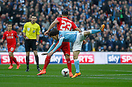Emre Can of Liverpool gets the ball while David Silva of Manchester City takes a tumble. Capital One Cup Final, Liverpool v Manchester City at Wembley stadium in London, England on Sunday 28th Feb 2016. pic by Chris Stading, Andrew Orchard sports photography.