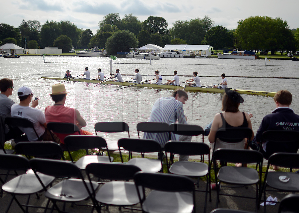 © Licensed to London News Pictures. 27/06/2012. Henley-on-Thames, UK Spectators watch rowing crews compete at the Henley Royal Regatta in the early evening sunshine on June 26, 2012 in Henley-on-Thames, England. The 172-year-old rowing regatta is held 27th June- 1st July 2012. Photo credit : Stephen Simpson/LNP